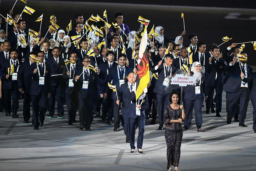 Athletes from Brunei marching into the National Stadium during the SEA Games opening ceremony on June 5, 2015. -- PHOTO: AFP