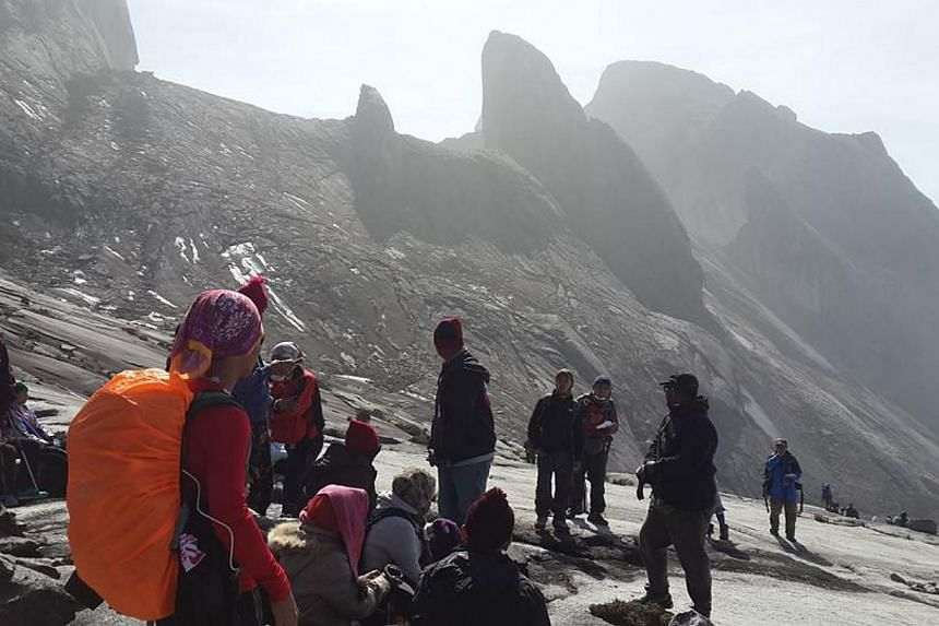 A picture,reportedly taken onMalaysia's Mount Kinabalu in Borneo on June 5, 2015, of climberswaiting for a helicopter after a6.0-magnitude earthquakestruck nearby. -- PHOTO: CHARLENE DMP/ FACEBOOK