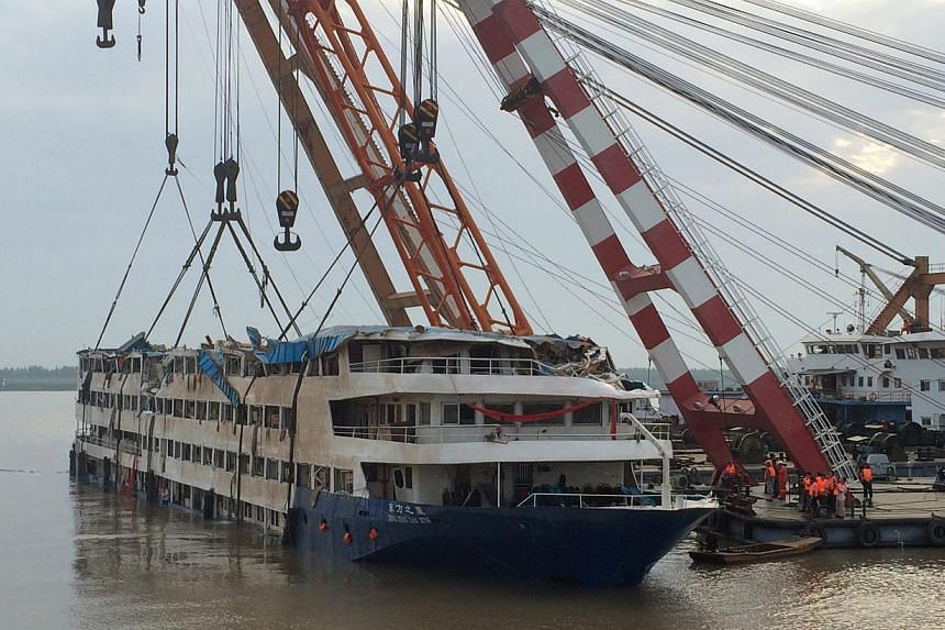 The cruise ship Dong Fang Zhi Xing, which capsized in the Yangtze River, after it was righted in Jianli county, southern China's Hubei province, June 5, 2015. -- PHOTO: EPA