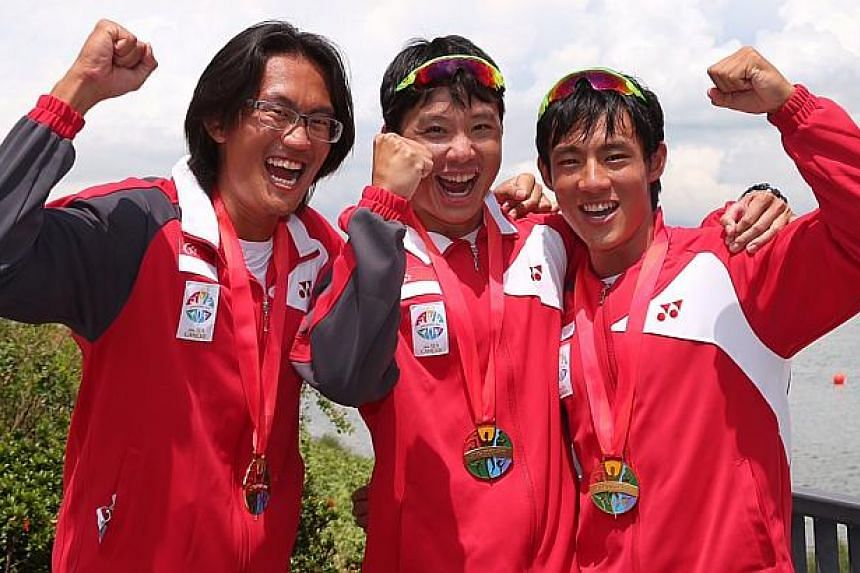 (From left) Gold medalists Lucas Teo, Bill Lee and Brandon Ooi with their medals. -- ST PHOTO: NEO XIAOBIN