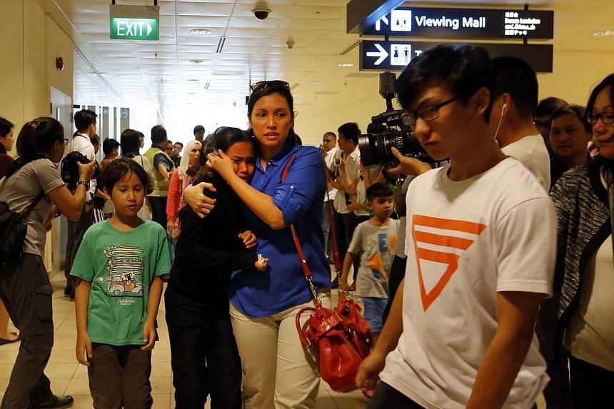 The first batch of pupils and teachers, who touched down on Saturday afternoon, were with their families at Changi Airport on Saturday afternoon. -- ST PHOTO: CHEW SENG KIM