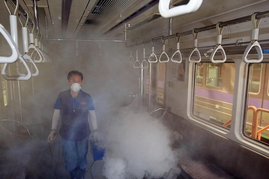 A subway train carriage in Seoul being disinfected on Thursday. The outbreak of Middle East respiratory syndrome in South Korea has claimed a fourth life and the number of confirmed cases has risen to 42.