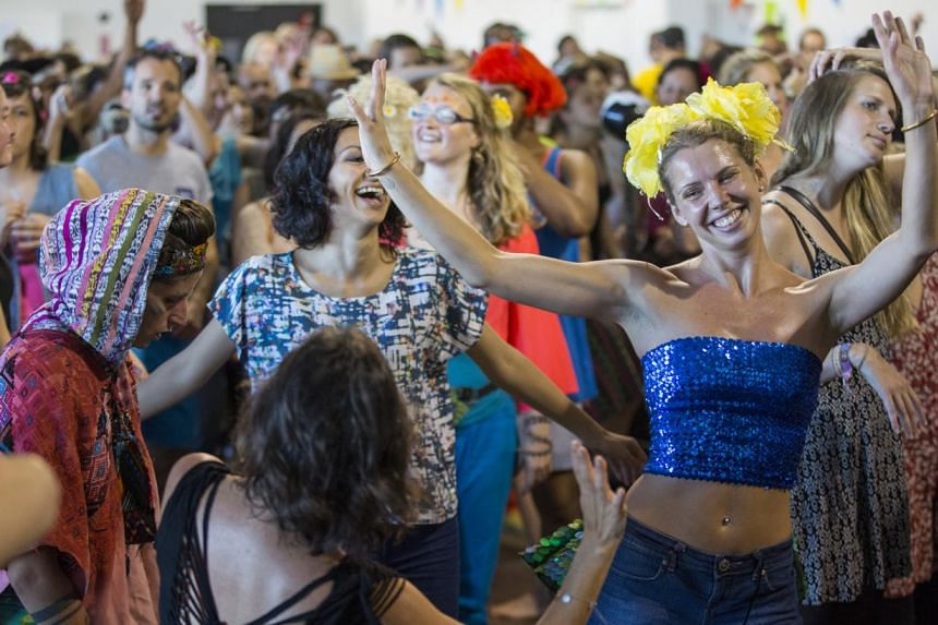 """Morning revellers jiving to music by a deejay at a """"conscious clubbing"""" session in London. The Singapore edition will be different from the others as it will serve food."""