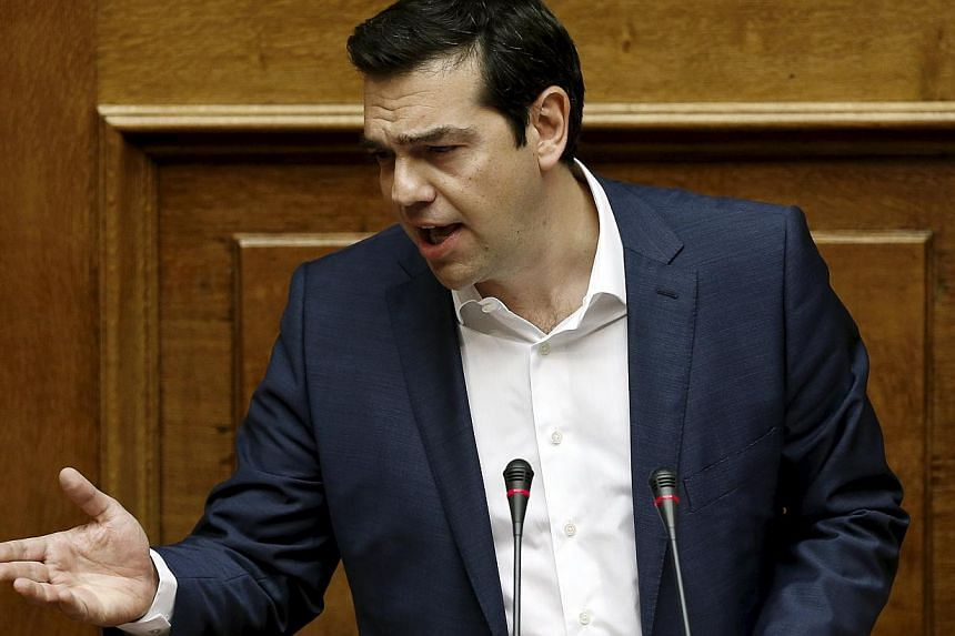 "Greek Prime Minister Alexis Tsipras delivers a speech during a parliamentary session to brief lawmakers over the ongoing talks with the country's lenders, in Athens, Greece, on June 5, 2015. The Greek PM said that the country was ""closer than ever to"
