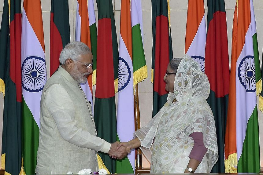 Indian Prime Minister Narendra Modi (left) shakes hand with Bangladeshi Prime Minister Sheikh Hasina Wajid after their meeting at the Prime Minister's Office in Dhaka on June 6, 2015. The two neighbours signed a historic pact on Friday to simpli