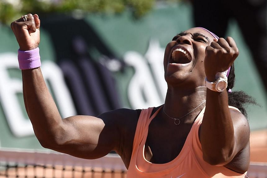 Serena Williams of the US celebrates after defeating Lucie Safarova of the Czech Republicduring their women's final match of the Roland Garros French Tennis Open in Paris on June 6, 2015. -- PHOTO: AFP