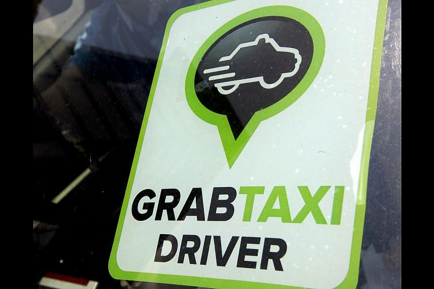 Transport app provider GrabTaxi is tying up with a rental company to grow a fleet of on-call taxis.-- PHOTO: ST FILE