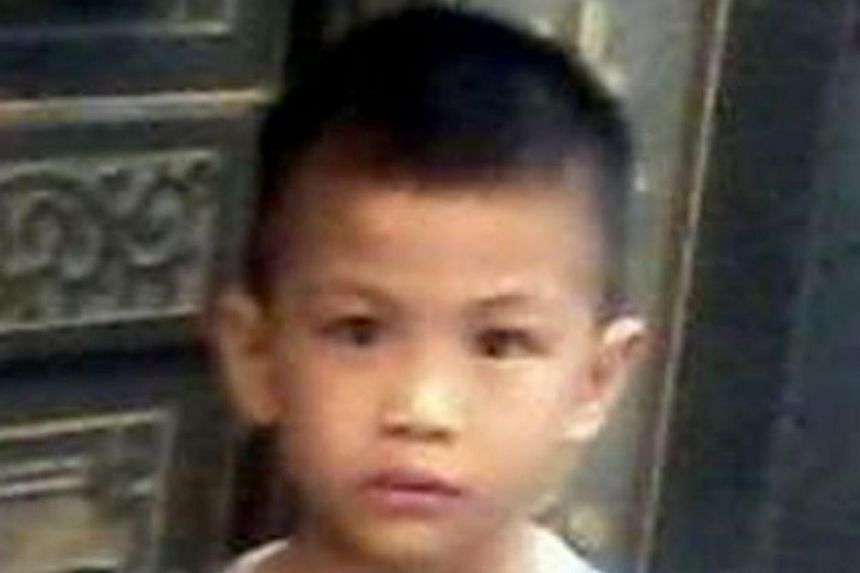 The boy found buried under the kitchen floor. The woman being investigated with her husband over the alleged murder and burial has claimed that she is also a victim. -- PHOTO: THE STAR/ASIA NEWS NETWORK