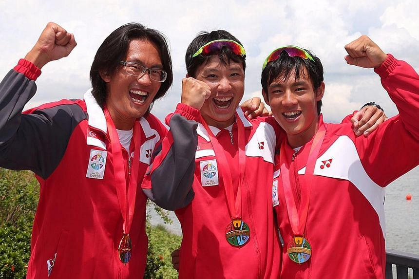Canoeists (from left) Lucas Teo, Bill Lee and Brandon Ooi got the ball rolling with two golds on Saturday morning. Singapore enjoyed a dream start to the first official day of the SEA Games, winning 10 medals across five sports. -- ST PHOTO: NEO XIAO