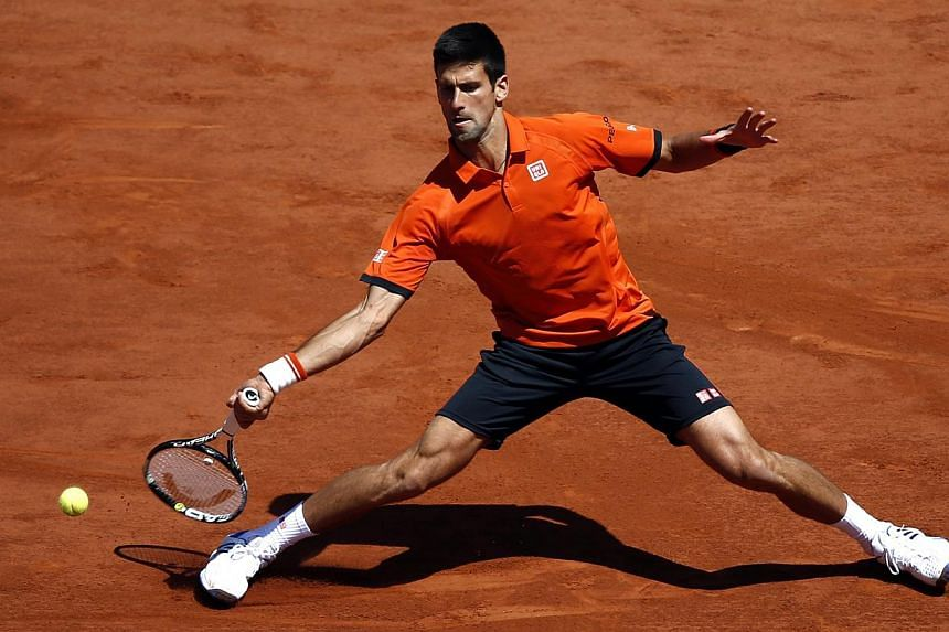 Novak Djokovic of Serbia in action against Andy Murray of Britain during their semifinal match for the French Open tennis tournament at Roland Garros in Paris, France on June 6, 2015. -- PHOTO: EPA