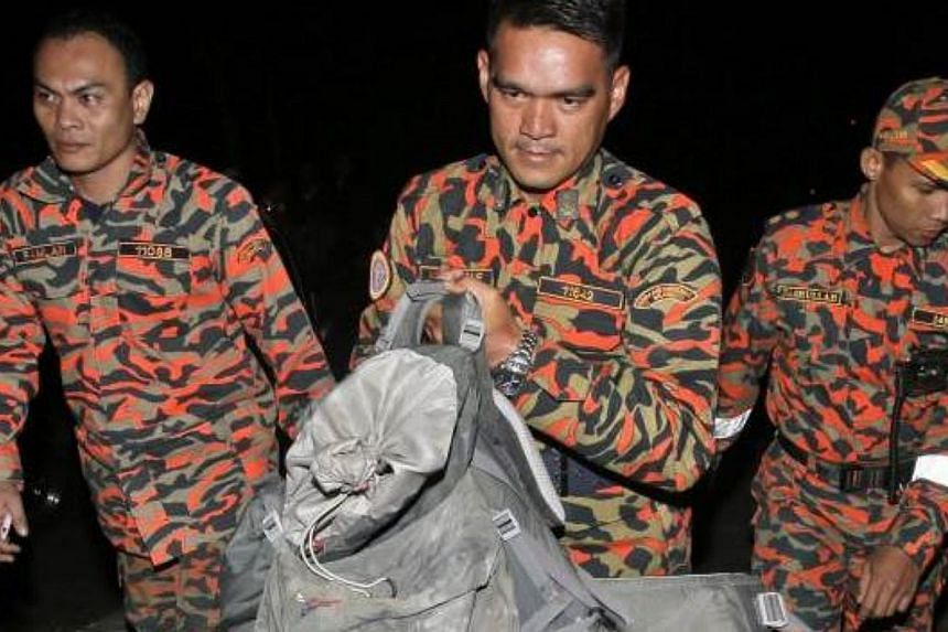 Efforts to bring down bodies of climbers from Mount Kinabalu have been hampered as some are crushed and pinned under tonnes of rocks and boulders after Friday's earthquake.-- PHOTO: THE STAR/ASIA NEWS NETWORK