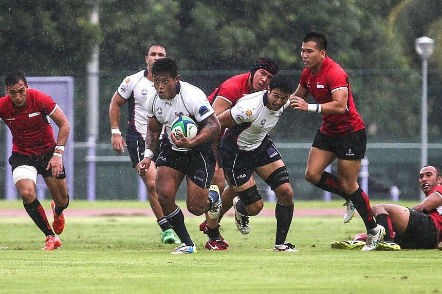 Singapore's men's rugby team in action at the Choa Chu Kang Stadium on June 6, 2015. -- PHOTO: THE NEW PAPER