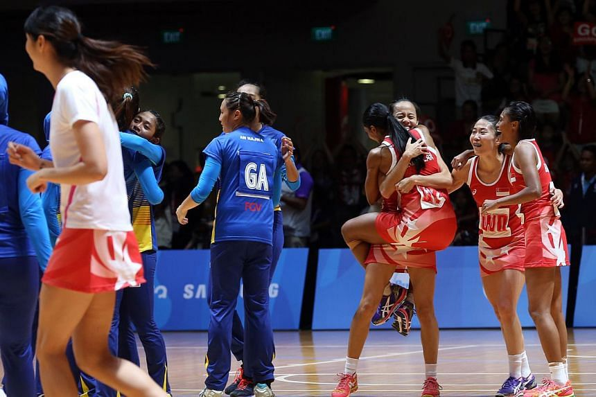 (From left) Singapore's Hirubalan Premila, Lin Qingyi, Ang Shiqi and Nurul Baizura celebrate at full time after beating Malaysia 46-43 in the 28th SEA Games Netball Finals on Sunday, June 7, 2015, at the OCBC Arena. -- ST PHOTO: SEAH KWANG PENG