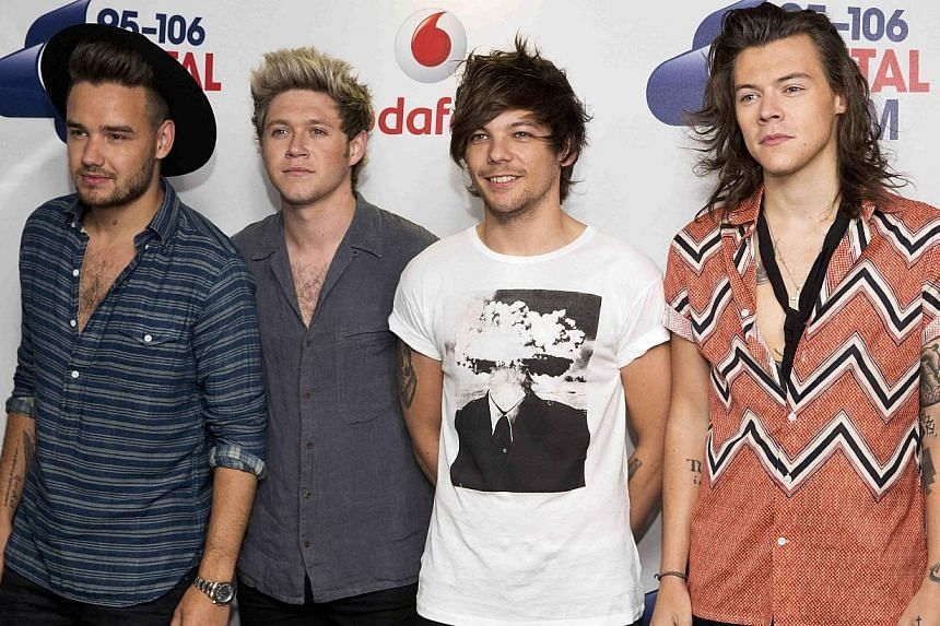 Members of boyband One Direction pose at the Capital Summertime Ball at Wembley Stadium in London, Britain on June 6, 2015. The British pop group insisted on Saturday they would not be splitting up despite the departure of band member Zayn Malik. --