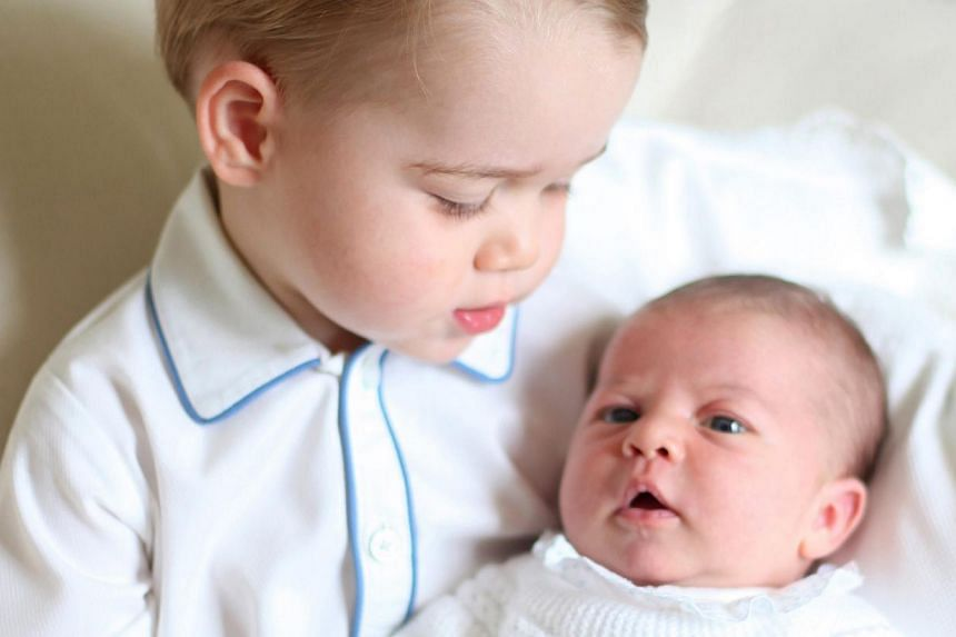 A handout photo released by Britain's Prince William, Duke of Cambridge, and his wife Catherine, The Duchess of Cambridge, on June 6, 2015, shows Prince George (left) and his sister Princess Charlotte at Anmer Hall in Norfolk, Britain, mid-May 2015.