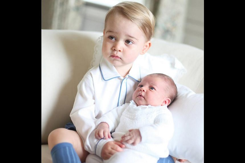 Prince George and Princess Charlotte are seen in this handout photo taken by the Duchess in mid-May at Anmer Hall in Norfolk and released by the Duke and Duchess of Cambridge on June 6, 2015. -- PHOTO: REUTERS