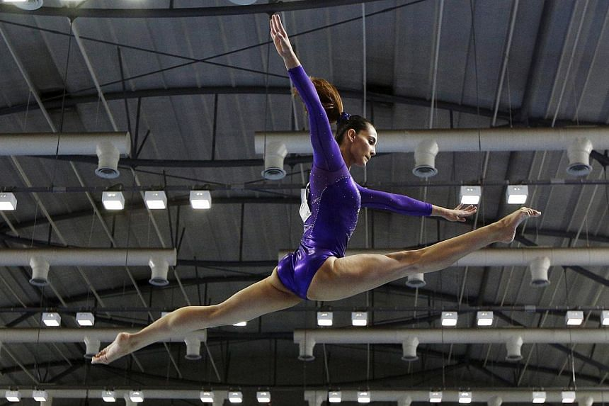 Malaysia's Farah Ann Abdul Hadi performing on the balance beam during the women's artistic gymnastics team final at the 28th SEA Games in Singapore on June 7, 2015. -- PHOTO: REUTERS