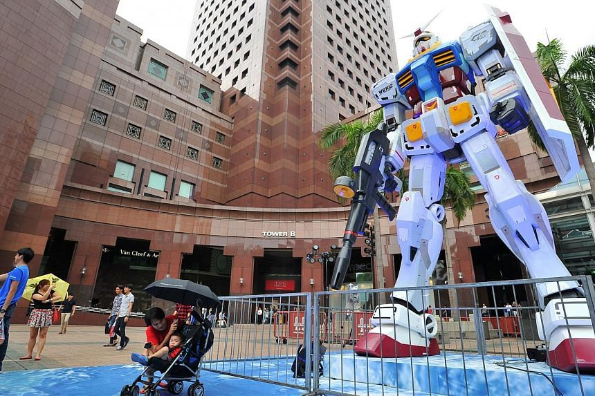 6m tall 1:3 scale model of RX-78-2 Gundam at the outdoor space of Ngee Ann City Civic Plaza on June 6, 2015. -- PHOTO: LIM YAOHUI FOR THE STRAITS TIMES