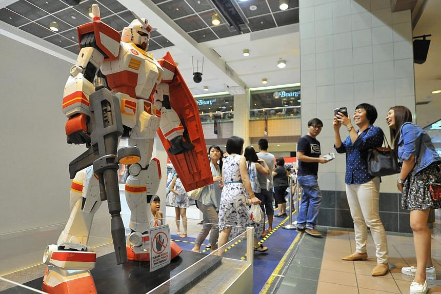 Exclusive SG50 Gundam model in the exhibition of over 200 Gundam models at Takashimaya Square on June 6, 2015. -- PHOTO: LIM YAOHUI FOR THE STRAITS TIMES