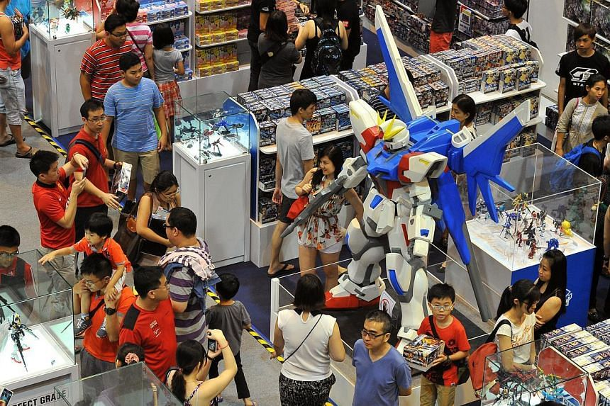 The exhibition with over 200 Gundam models at Takashimaya Square on June 6, 2015. -- PHOTO: LIM YAOHUI FOR THE STRAITS TIMES