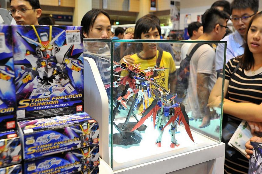 Gundam models on display in the exhibition of over 200 Gundam models at Takashimaya Square on June 6, 2015. -- PHOTO: LIM YAOHUI FOR THE STRAITS TIMES