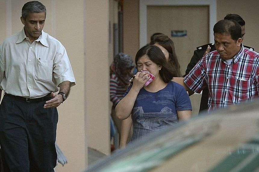 Family members of Tanjong Katong Primary School pupils outside the mortuary in Kota Kinabalu. The bodies of five more pupils and one teacher from the school have been identified, the Ministry of Education confirmed on Sunday, June 7, 2015. -- ST PHOT