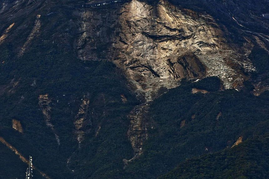 A general view of a landlside on the side of the Kinabalu Mountain as a rescue mission continues for more than 130 climbers stranded on one of Southeast Asia's highest mountains after an earthquake, Sabah, in Kundasang, Malaysia, on June 6, 2015. --