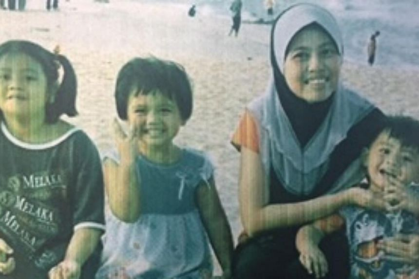 Police are appealing for information on the whereabouts of a woman and her three children. -- PHOTO: SINGAPORE POLICE FORCE
