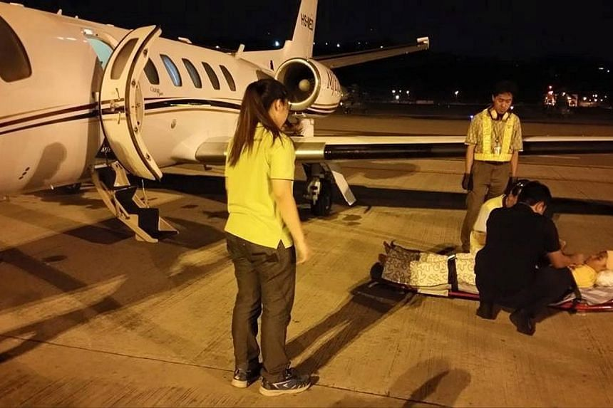 Emyr Uzayr, 12, was flown back to Singapore with his parents on an International SOS air ambulance on Sunday morning (June 7). The other pupil took a separate flight. Both arrived at about 3am. -- PHOTO: NUR DAN SADRI/FACEBOOK
