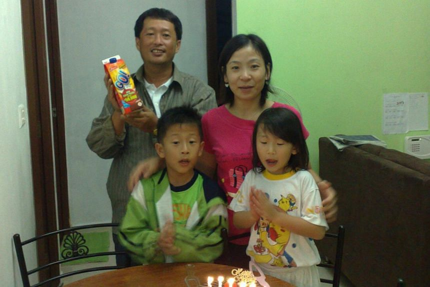 Peony (in white) celebrating her sixth birthday with her parents and brother, Chester. -- PHOTO: COURTESY OF ALSON WEE