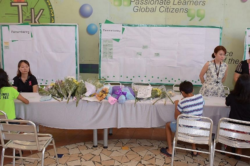 Well-wishes have been pouring in for the missing pupils and teachers at Tanjong Katong Primary School on Sunday morning, after the school set up a site for people to pen notes of hope for those still not found. -- ST PHOTO: DESMOND WEE