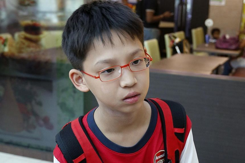 RIGHT: Primary Six pupil Ronan Lim fell and sprained his ankle in the rush and a Malaysian guide carried him the rest of the way down the mountain. BELOW: A distraught pupil from Tanjong Katong Primary School arriving at Changi Airport yesterday.