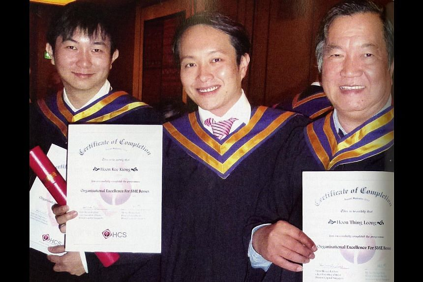 Mr Hoon Thing Leong and his sons (from left) Alfred and Andy after graduating from their professional diploma course on organisational excellence, organised by Human Capital Singapore.