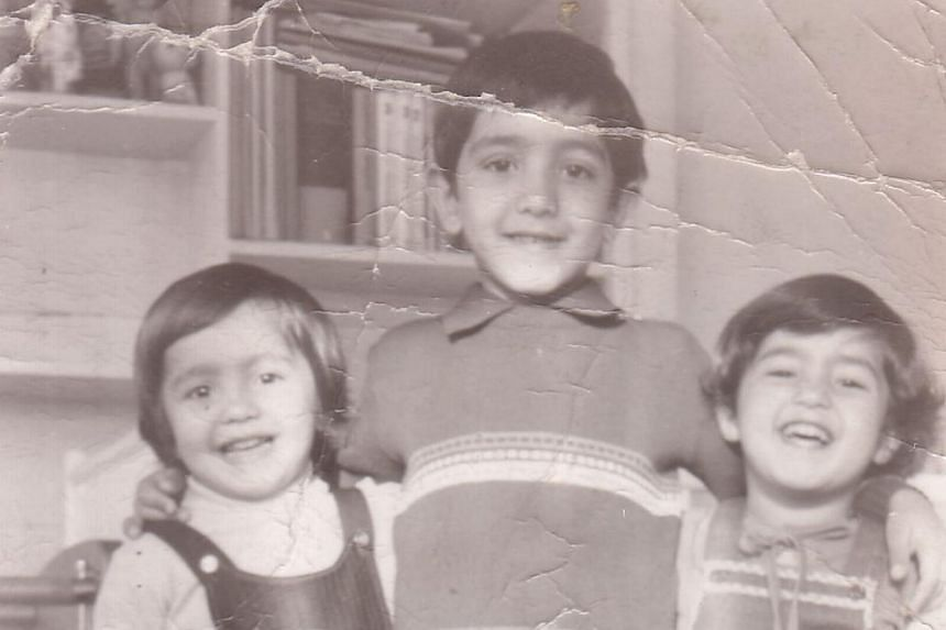 In 2004, Geraldine Ang (left) spent a year in Tigray, northern Ethiopia, working in a refugee camp which housed 10,000 people. A childhood photograph of Mr Schoeib Sabri (centre) with his brother Mustafa (left) and sister Maryam (right). The photo is