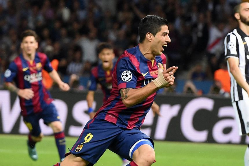 Barcelona's Luis Suarez (centre) celebrating after scoring to give his team a 2-1 lead during the UEFA Champions League final soccer match against Juventus during the Champions' League final at Olympiastadion in Berlin, Germany, on June 6, 2015. Addi
