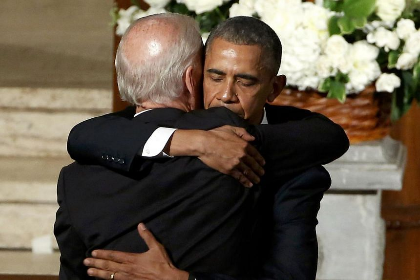 US President Barack Obama (right) hugs Vice-President Joe Biden during the funeral of the latter's son, former Delaware attorney-general Beau Biden, at St. Anthony of Padua Church in Wilmington, Delaware on June 6, 2015. -- PHOTO: REUTERS
