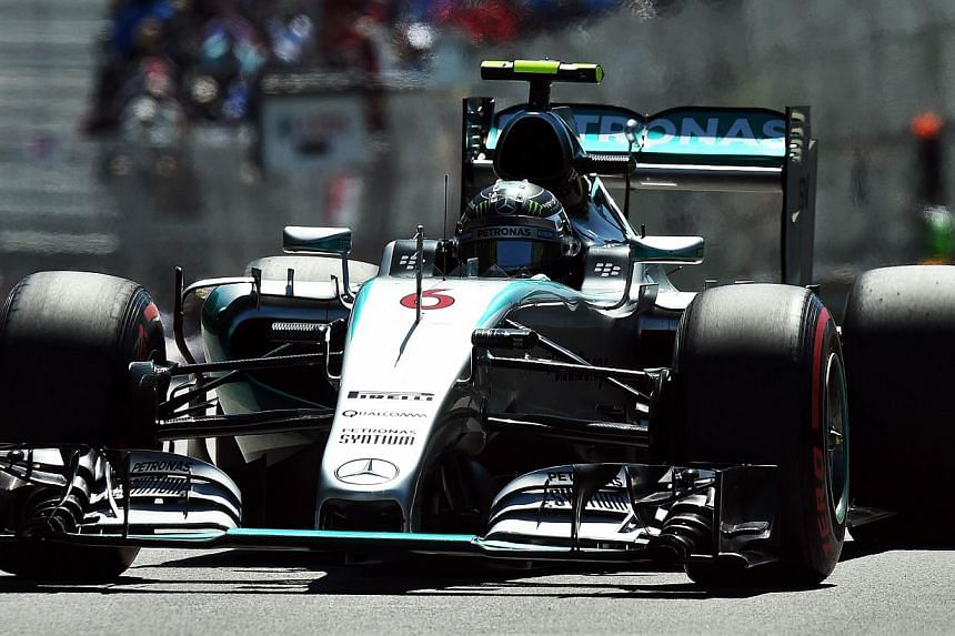 Mercedes AMG Petronas German driver Nico Rosberg races at the Circuit Gilles Villeneuve in Montreal on June 6, 2015. Rosberg finished in first place after the final free practice session, while teammate Lewis Hamilton of Britain ended up last. -- PHO