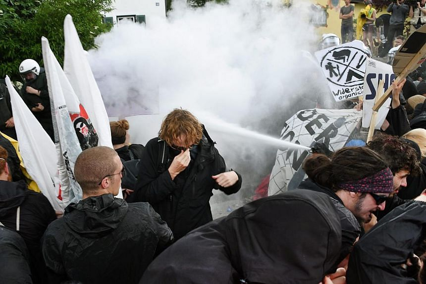 Protestors and police officers clash duirng a protest in Garmisch-Partenkirchen, Germany, on June 6, 2015. Police reported isolated incidents and in one case deployed pepper spray to disperse some protesters, but the demonstration against the G7
