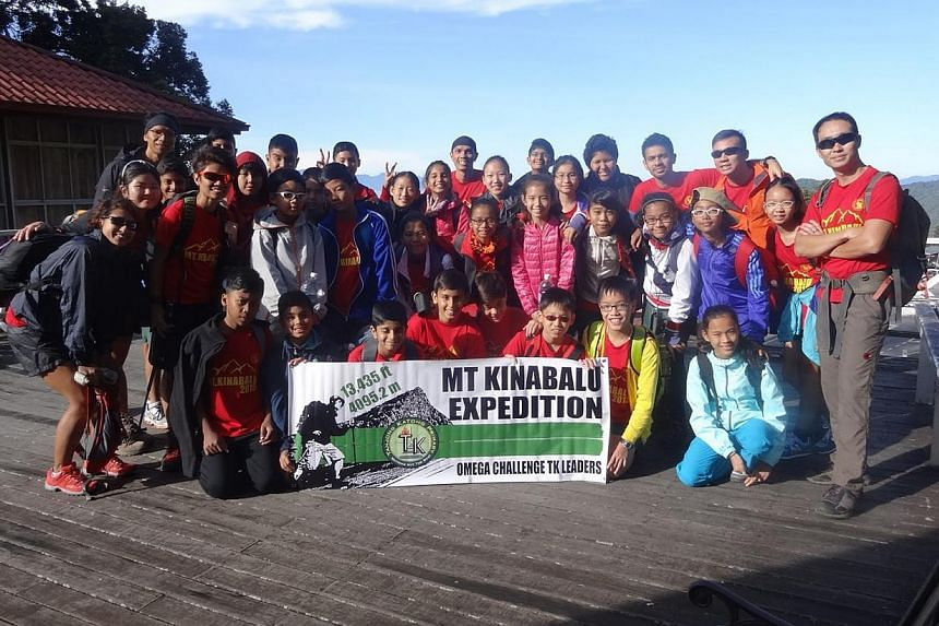 The Tanjong Katong Primary School team which went on the Mount Kinabalu expedition taking a group shot last Thursday. -- PHOTO: TANJONG KATONG PRIMARY SCHOOL