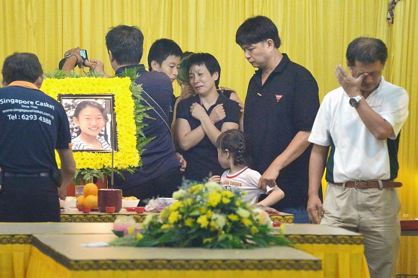 Peony Wee's mother (centre, in black with arms crossed), brother (right of mother), and father (right, in white) at her wake at Jalan Tiga. -- ST PHOTO: ALPHONSUS CHERN