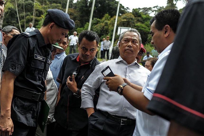 Malaysia's Deputy Prime Minister Muhyiddin Yassin (second right) waits after being evacuated following an aftershock while at the Liwagu Restaurant for a press conference, near Mount Kinabalu in Kundasang, a town in the district of Ranau on June 7, 2