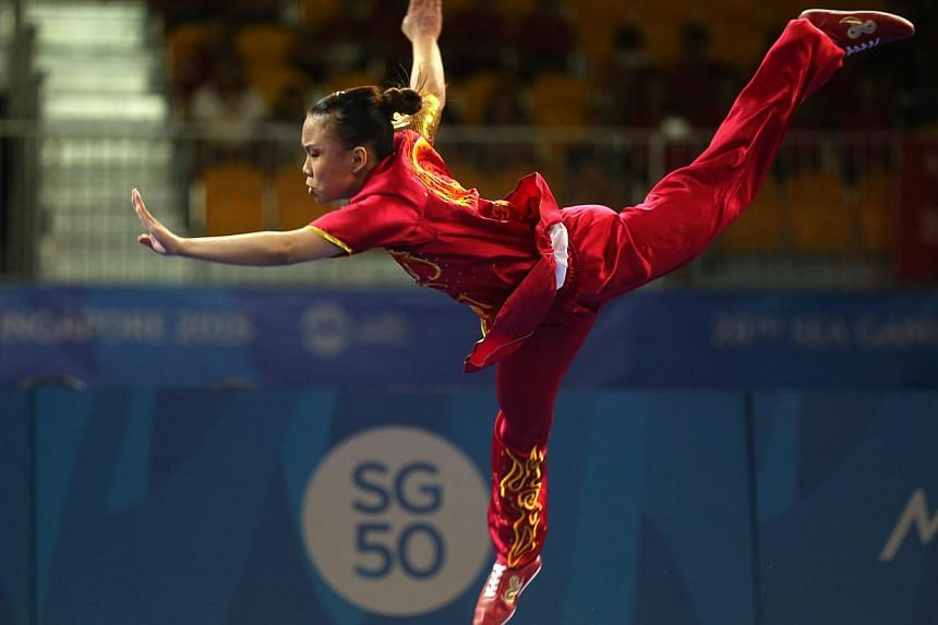 Singapore's Zoe Mui clinched the gold in the women's changquan (optional) event held at the Singapore Expo on June 7, 2015. -- ST PHOTO: SEAH KWANG PENG