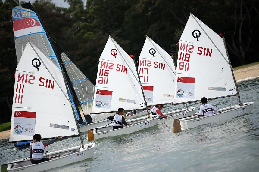 Singapore's optimist sailors had to settle for a SEA Games silver in the team event on Sunday afternoon, after they lost 2-0 to Malaysia in a best-of-three match race final. -- PHOTO: ZAO BAO