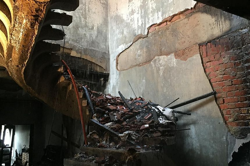 Staircase leading to the second floor of the unit. A fire broke out at the house in Yio Chu Kang early on Tuesday morning (June 9), killing two people and injuring six others. -- PHOTO: SCDF