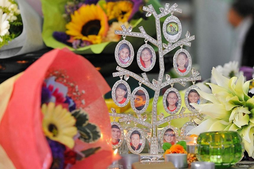 An ornament stand displaying the photographs of the victims of the June 6 Mount Kinabalu earthquake. -- PHOTO: LIM YAOHUI FOR THE STRAITS TIMES
