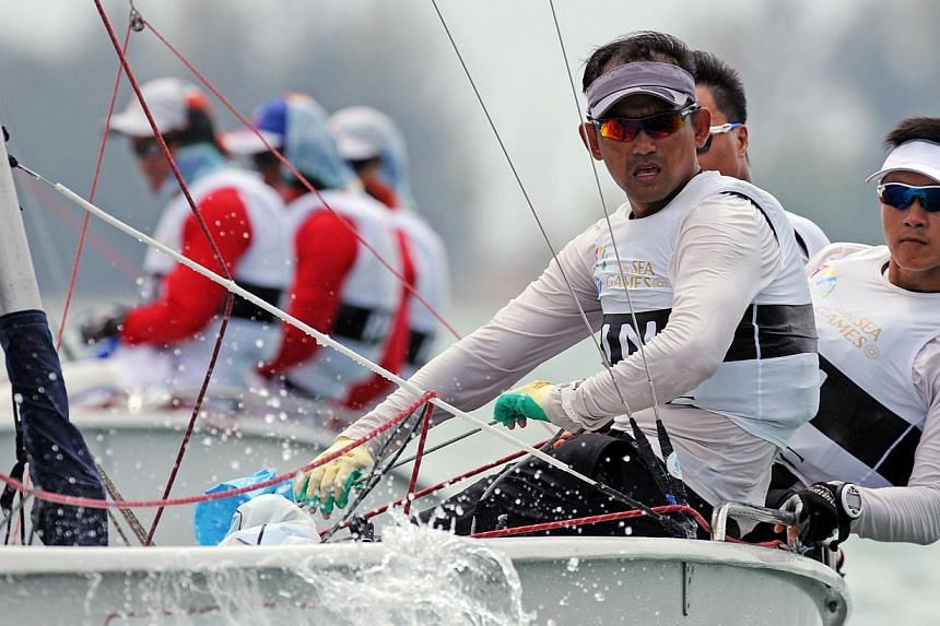 The trio of Stanley Chan, Anthony Kiong and Colin Ng clinched the third gold in themen's keelboat fleet racing.-- PHOTO:SINGAPORE SEA GAMES ORGANISING COMMITEE/ACTION IMAGES VIA REUTERS