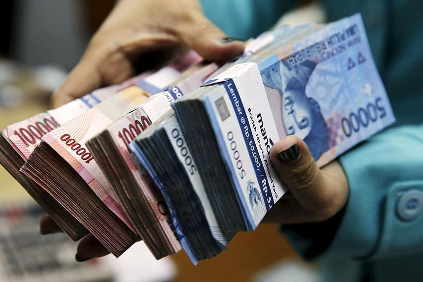 Indonesia's central bank said on Tuesday there is a risk of a global currency war as the dollar gains strength but the rupiah will not be involved. -- PHOTO: REUTERS