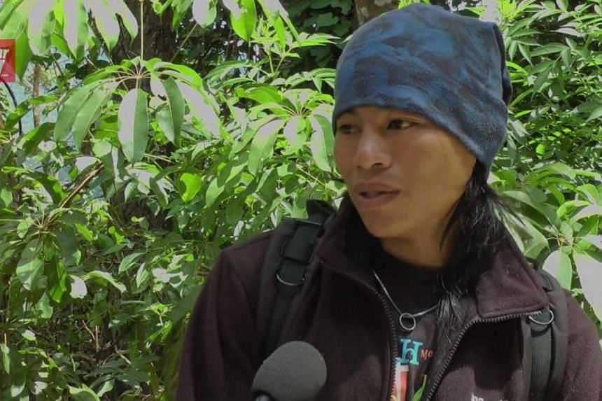 Mountain guide Mhd Rizuan Kauhinin hopes to meet the boy he rescued after the earthquake on Mount Kinabalu on June 6, 2015. -- PHOTO: SCREENGRAB FROM YOUTUBE