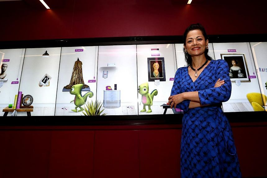 The Pinacotheque's 8m-long interactive wall presents bite-size facts to visitors, says the museum's chief executive Suguna Madhavan (above). -- ST PHOTO: CHEW SENG KIM