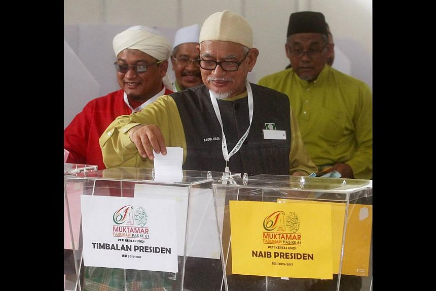 Parti Islam SeMalaysia president Abdul Hadi Awang casting his vote at the party elections last week. The pro-ulama group outvoted the professionals and won almost all the seats in the main executive committee while expanding their dominance to the yo